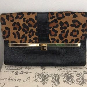 Charming Charlie's leopard clutch